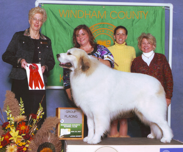 Devon pictured with owners Karen, Amy, and Charlene.